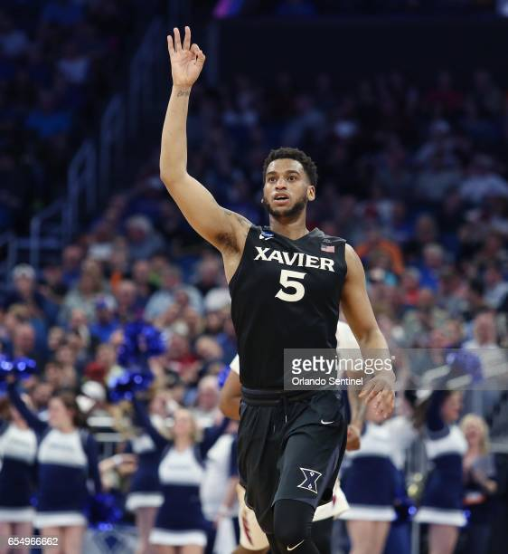 Xavier's Trevon Bluiett celebrates after hitting a 3point shot against Florida State in the second round of the NCAA Tournament at the Amway Center...