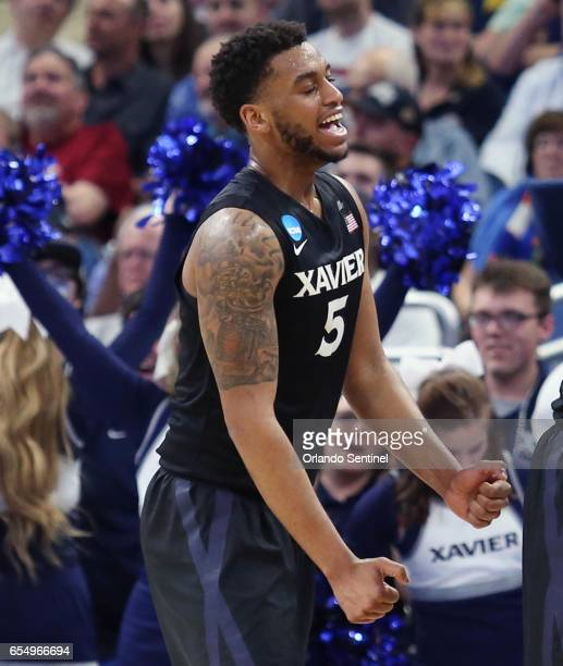 Xavier's Trevon Bluiett celebrates during action against Florida State in the second round of the NCAA Tournament at the Amway Center in Orlando Fla...