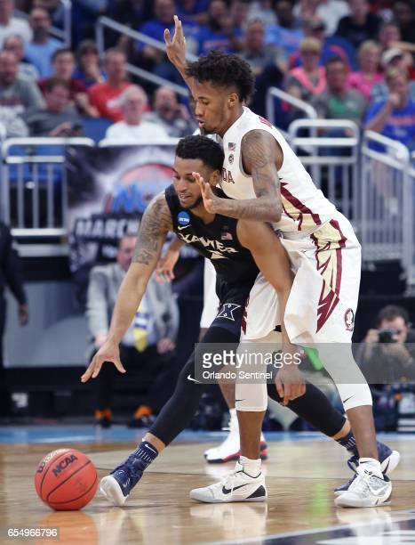 Xavier's Trevon Bluiett left keeps the ball away from Florida State's Braian AngolaRodas in the second round of the NCAA Tournament at the Amway...