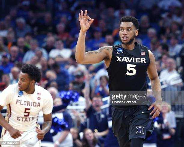 Xavier's Trevon Bluiett right celebrates after hitting a 3point shot against Florida State in the second round of the NCAA Tournament at the Amway...