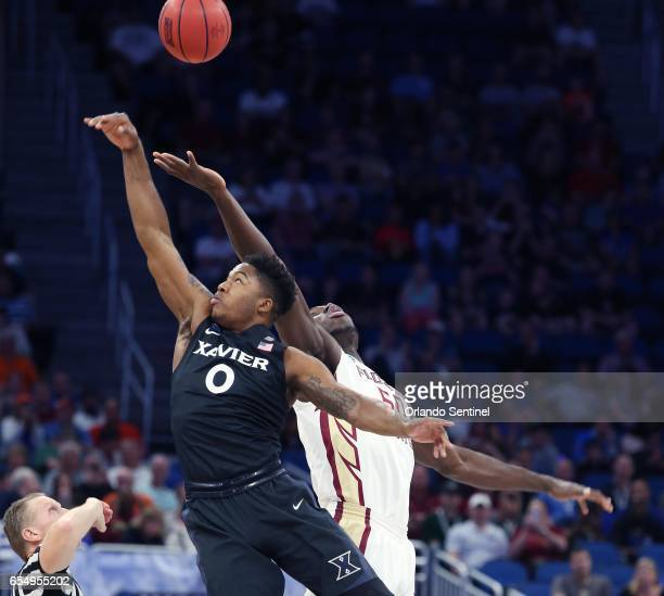 Xavier's Tyrique Jones and Florida State's Michael Ojo tip off in the second round of the NCAA Tournament at the Amway Center in Orlando Fla on...