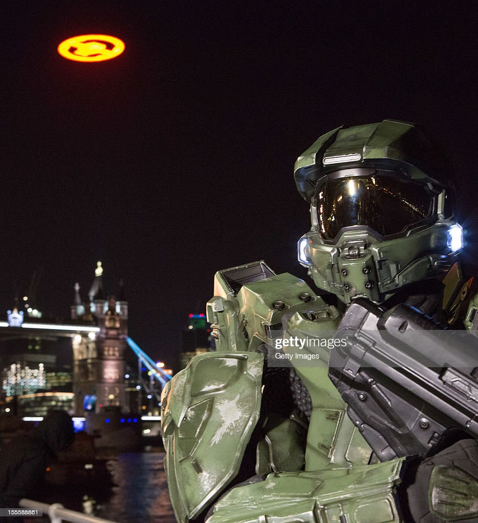 Xbox 360 takes over London's skies to launch 'Halo 4'. Fans and spectators were treated to an aerial lighting performance visable for miles over London. / Master Chief joins fans for the spectacular flight of the 'Halo 4' glyph to mark the launch of Halo 4 on Xbox 360. / the 'Halo 4' glyph symbol is one of the largest and brightest manmade structures to ever fly over a capital city and measures 50 feet in diameter and weighs over 3 tons at Tower Bridge on November 5, 2012 in London, England.