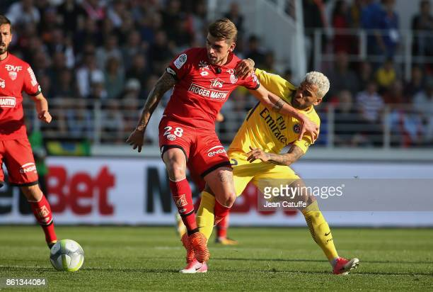 Xeka of Dijon Dani Alves aka Daniel Alves of PSG during the French Ligue 1 match between Dijon FCO and Paris Saint Germain at Stade Gaston Gerard on...