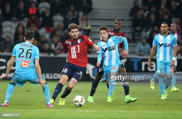 Xeka of Lille and Maxime Lopez of OM in action during the French Ligue 1 match between Lille OSC and Olympique de Marseille at Stade PierreMauroy on...