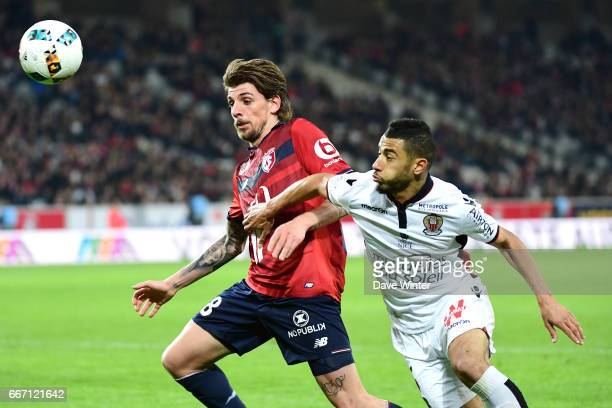 Xeka of Lille and Younes Belhanda of Nice during the French Ligue 1 match between Lille OSC and OGC Nice at Stade PierreMauroy on April 7 2017 in...