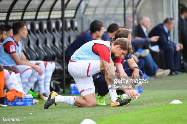 Xeka of Lille puts on his socks during the Ligue 1 match between Angers SCO and Lille OSC at Stade Raymond Kopa on August 27 2017 in Angers