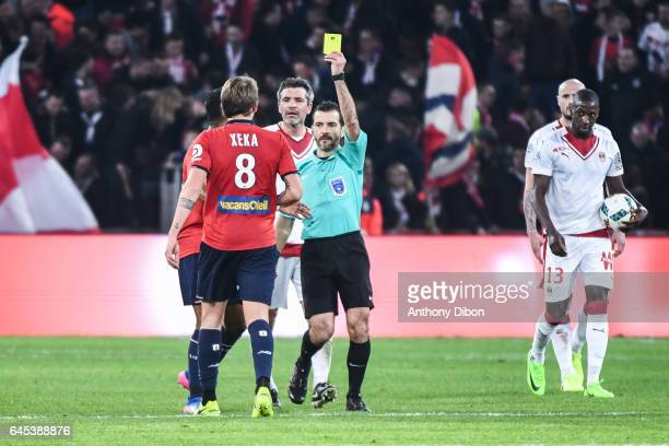 Xeka of Lille receive a yellow card during the French Ligue 1 match between Lille and Bordeaux at Stade PierreMauroy on February 25 2017 in Lille...