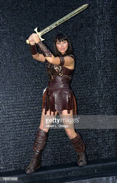 Warrior Princess holding a solid gold sword with an estimated value of $10000000