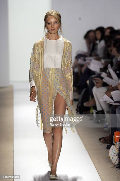 Xenia Markova wearing Atil Kutoglu Spring 2006 during Olympus Fashion Week Spring 2006 Atil Kutoglu Runway at Bryant Park in New York City New York...