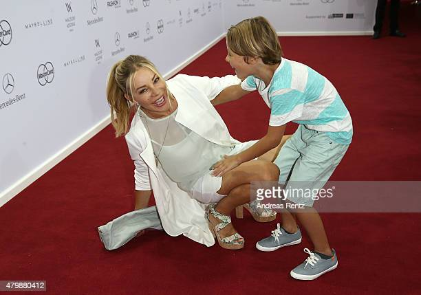 Xenia Seeberg and her son attend the Minx by Eva Lutz show during the MercedesBenz Fashion Week Berlin Spring/Summer 2016 at Brandenburg Gate on July...
