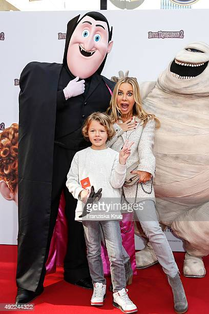 Xenia Seeberg and her son Philias Seeberg attend the 'Hotel Transsilvanien 2' German Premiere on October 11 2015 in Berlin Germany
