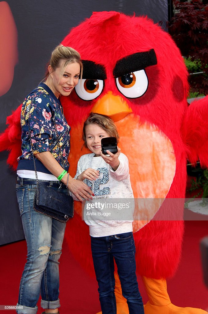 Xenia Seeberg and her son Philip-Elias Martinek attend the Berlin premiere of the film 'Angry Birds - Der Film' at CineStar on May 1, 2016 in Berlin, Germany.