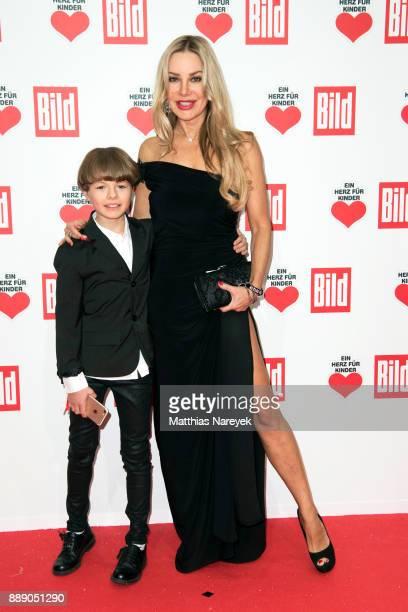 Xenia Seeberg and her son PhilipElias Martinek attend the Ein Herz Fuer Kinder Gala at Studio Berlin Adlershof on December 9 2017 in Berlin Germany