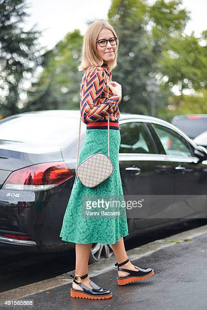 Xenia Sobchak poses wearing Gucci top skirt and bag and Stella McCartney shoes after the Chanel show at the Grand Palais during Paris Fashion Week...