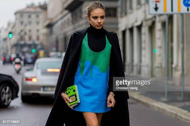 Xenia Tchoumitcheva wearing a Pinko coat Au Jour Le Jour dress seen outside Blumarine during Milan Fashion Week Fall/Winter 2016/17 on February 27...