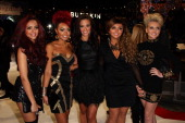 Factor judge Tulisa Contostavlos and Perrie Edwards LeighAnne Pinnock Jade Thirwall and Jesy Nelson from X Factor group Little Mix attend the UK...