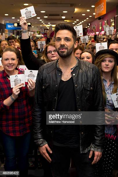 Factor winner Ben Haenow poses with fans during a meet and greet to sign copies of his debut single 'Something I Need' at HMV store Queen Street on...