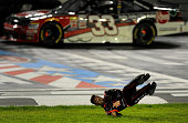Xfinity Series driver Austin Dillon flips through the infield grass at Charlotte Motor Speedway in Concord NC as he celebrates his victory in the...