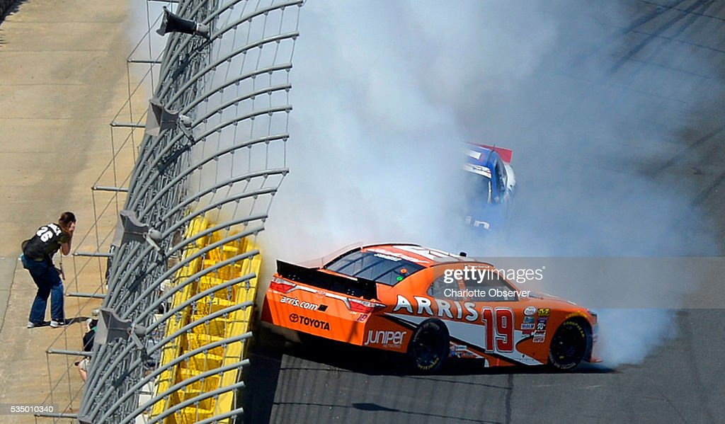 Xfinity Series driver Daniel Suarez (19) and Elliott Sadler (1) wreck coming out of Turn 4 during the 35th Annual Hisense 300 at Charlotte Motor Speedway in Concord, N.C., on Saturday, May 28, 2016.