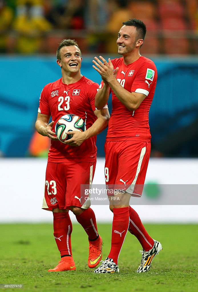 <a gi-track='captionPersonalityLinkClicked' href=/galleries/search?phrase=Xherdan+Shaqiri&family=editorial&specificpeople=6923918 ng-click='$event.stopPropagation()'>Xherdan Shaqiri</a> (L) and Josip Drmic of Switzerland celebrate after the 3-0 win in the 2014 FIFA World Cup Brazil Group E match between Honduras and Switzerland at Arena Amazonia on June 25, 2014 in Manaus, Brazil.