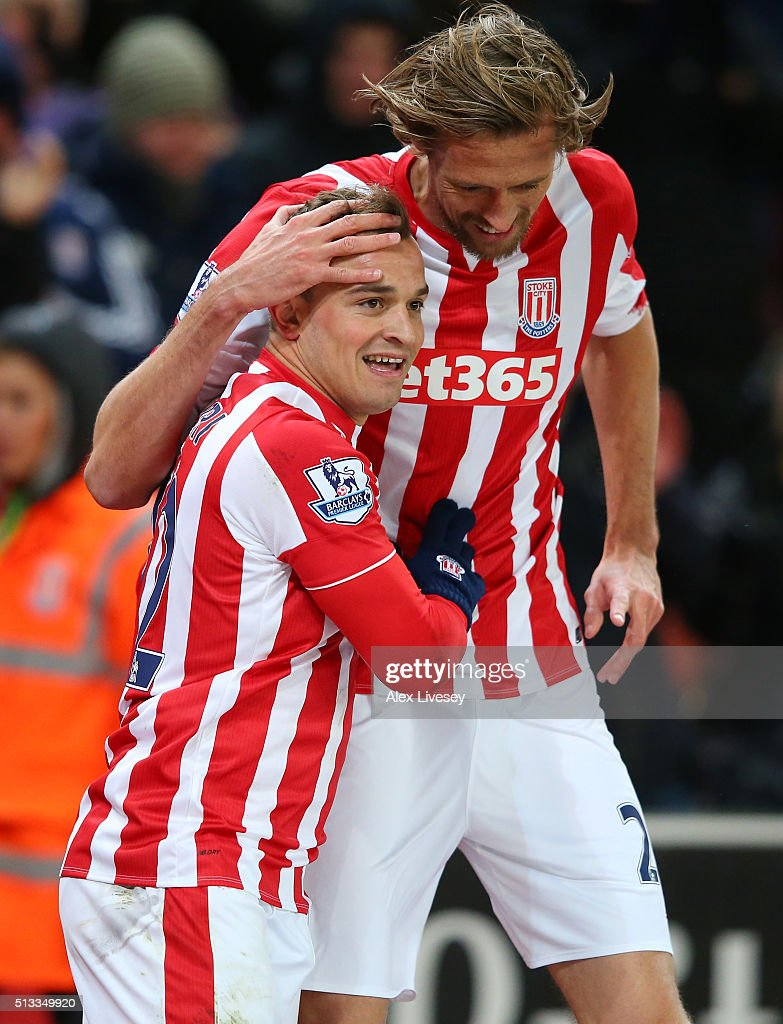 Xherdan Shaqiri celebrates with Peter Crouch after scoring the opening goal during the Barclays Premier League match between Stoke City and Newcastle United at the Britannia Stadium on March 2, 2016 in Stoke on Trent, England.