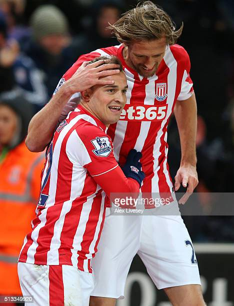 Xherdan Shaqiri celebrates with Peter Crouch after scoring the opening goal during the Barclays Premier League match between Stoke City and Newcastle...
