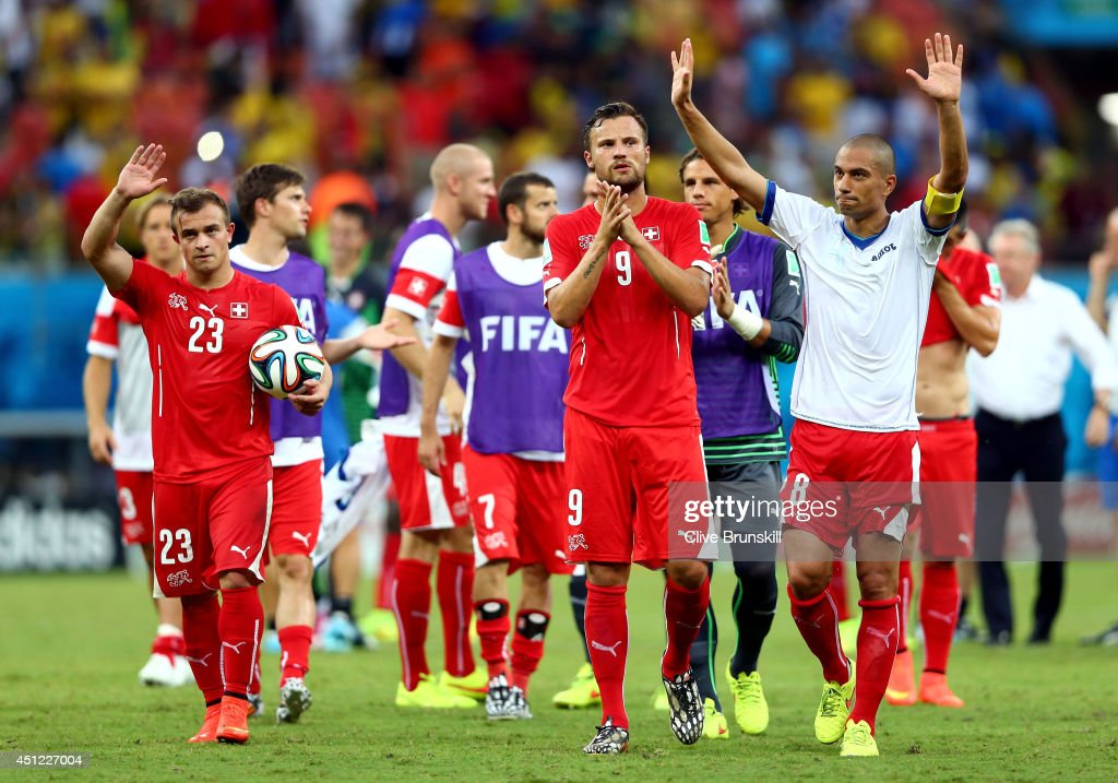 <a gi-track='captionPersonalityLinkClicked' href=/galleries/search?phrase=Xherdan+Shaqiri&family=editorial&specificpeople=6923918 ng-click='$event.stopPropagation()'>Xherdan Shaqiri</a>, Haris Seferovic and Gokhan Inler of Switzerland acknowledge the fans after a 3-0 victory over Honduras in the 2014 FIFA World Cup Brazil Group E match between Honduras and Switzerland at Arena Amazonia on June 25, 2014 in Manaus, Brazil.