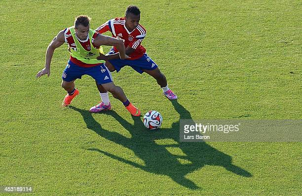 Xherdan Shaqiri is challenged by Julian Green during a Bayern Muenchen training session at day six of the Audi Summer Tour USA 2014 on August 4 2014...