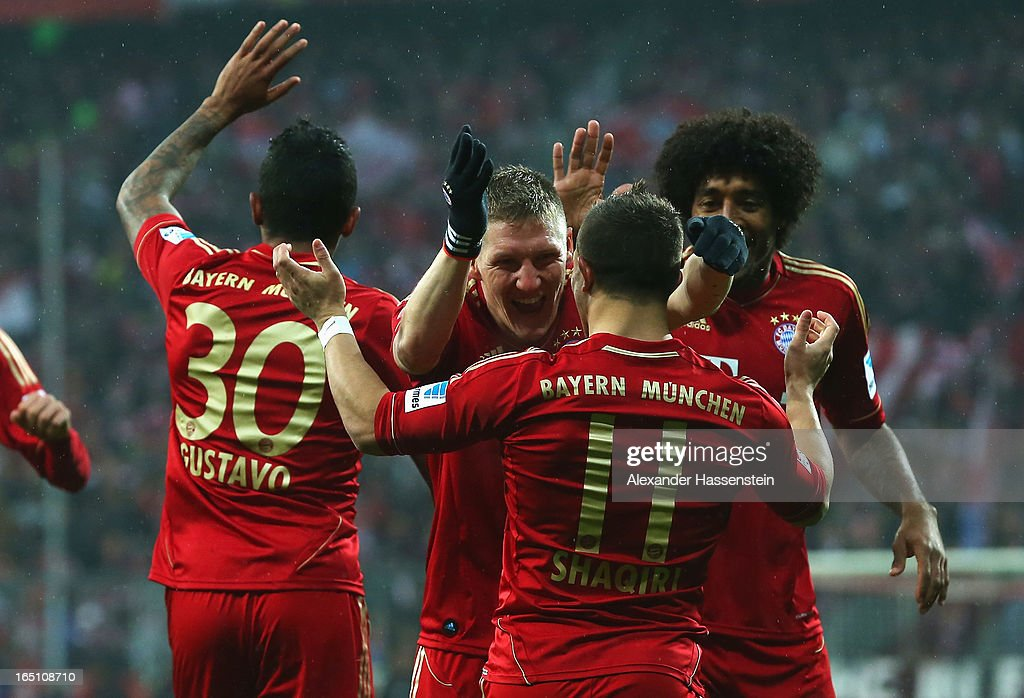 Xherdan Shaqiri of Bayern Muenchen is congratulated by Bastian Schweinsteiger after scoring the opening goal during the Bundesliga match between FC Bayern Muenchen and Hamburger SV at Allianz Arena on March 30, 2013 in Munich, Germany.