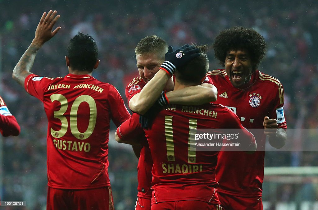 Xherdan Shaqiri of Bayern Muenchen is congratulated by Bastian Schweinsteiger and Dante after scoring the opening goal during the Bundesliga match between FC Bayern Muenchen and Hamburger SV at Allianz Arena on March 30, 2013 in Munich, Germany.