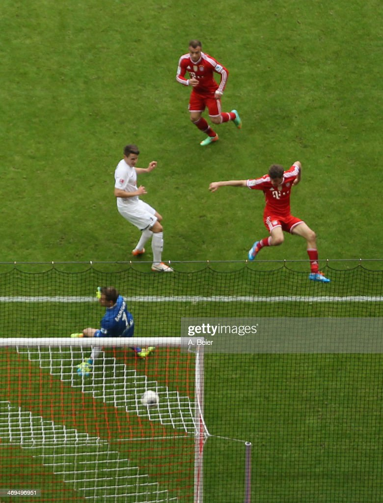 <a gi-track='captionPersonalityLinkClicked' href=/galleries/search?phrase=Xherdan+Shaqiri&family=editorial&specificpeople=6923918 ng-click='$event.stopPropagation()'>Xherdan Shaqiri</a> (top) of Bayern Muenchen scores a goal against goalkeeper <a gi-track='captionPersonalityLinkClicked' href=/galleries/search?phrase=Oliver+Baumann&family=editorial&specificpeople=4645207 ng-click='$event.stopPropagation()'>Oliver Baumann</a> (bottom) of Freiburg during the Bundesliga match between FC Bayern Muenchen and SC Freiburg at Allianz Arena on February 15, 2014 in Munich, Germany.