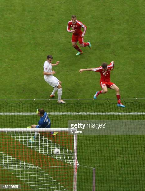 Xherdan Shaqiri of Bayern Muenchen scores a goal against goalkeeper Oliver Baumann of Freiburg during the Bundesliga match between FC Bayern Muenchen...