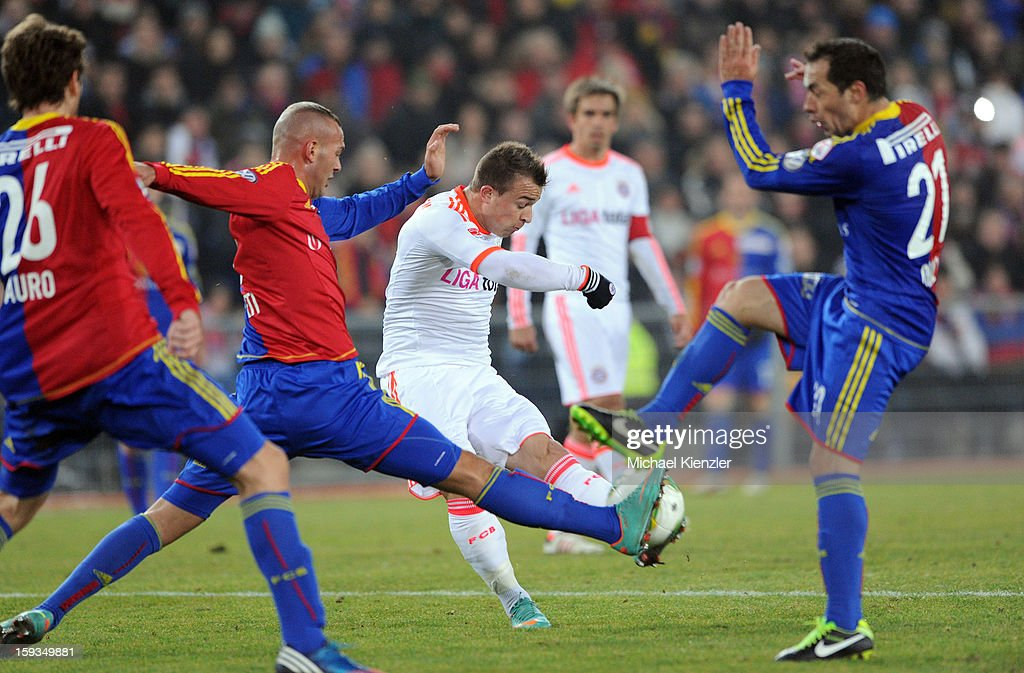 <a gi-track='captionPersonalityLinkClicked' href=/galleries/search?phrase=Xherdan+Shaqiri&family=editorial&specificpeople=6923918 ng-click='$event.stopPropagation()'>Xherdan Shaqiri</a> (C) of Bayern Munich in action against Gaston Sauro (L), Arlind Ajeti (2nd L) and Marcelo Diaz (R) of FC Basel during the friendly match between FC Basel and Bayern Munich at Stadium St. Jakob on January 12, 2013 in Basel, Switzerland.