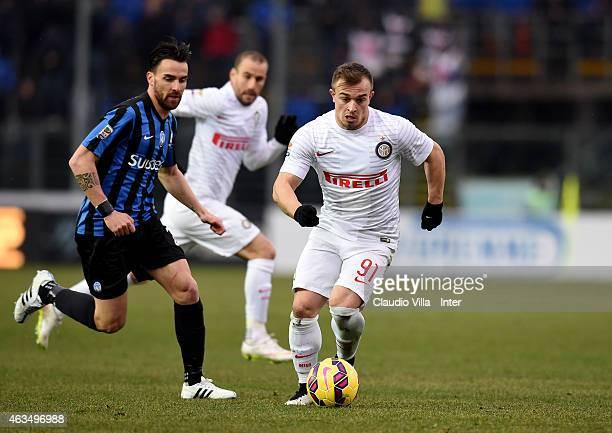 Xherdan Shaqiri of FC Internazionale and Luca Cigarini of Atalanta BC compete for the ball during the Serie A match between Atalanta BC and FC...