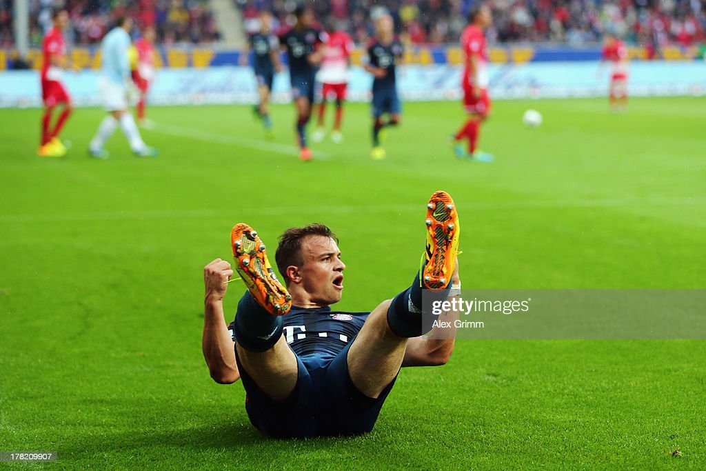 <a gi-track='captionPersonalityLinkClicked' href=/galleries/search?phrase=Xherdan+Shaqiri&family=editorial&specificpeople=6923918 ng-click='$event.stopPropagation()'>Xherdan Shaqiri</a> of Muenchen celebrates his team's first goal during the Bundesliga match between SC Freiburg and FC Bayern Muenchen at MAGE SOLAR Stadium on August 27, 2013 in Freiburg im Breisgau, Germany.