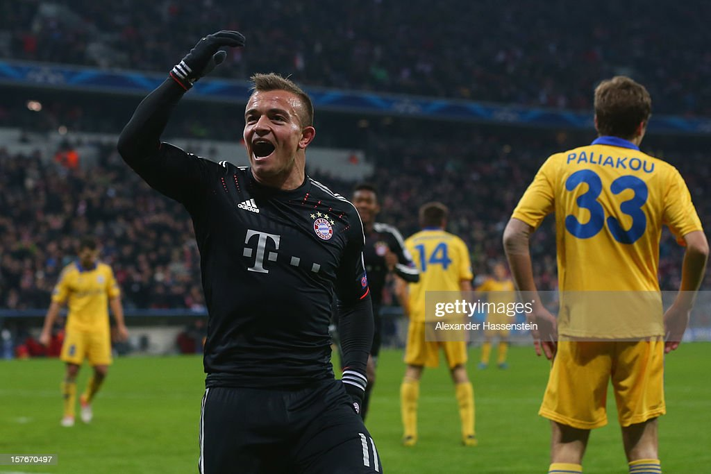 <a gi-track='captionPersonalityLinkClicked' href=/galleries/search?phrase=Xherdan+Shaqiri&family=editorial&specificpeople=6923918 ng-click='$event.stopPropagation()'>Xherdan Shaqiri</a> of Muenchen celebrates scoring the 3rd team goal during the UEFA Champions League Group F match between FC Bayern Muenchen and FC BATE Borisov at Allianz Arena on December 5, 2012 in Munich, Germany.
