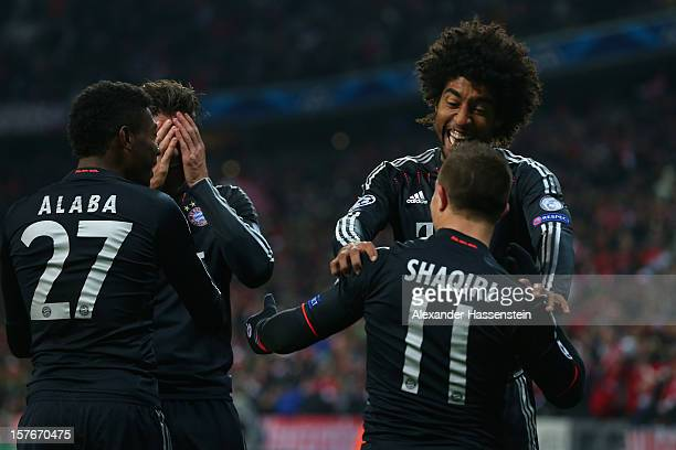 Xherdan Shaqiri of Muenchen celebrates scoring the 3rd team goal with his team mate Dante during the UEFA Champions League Group F match between FC...