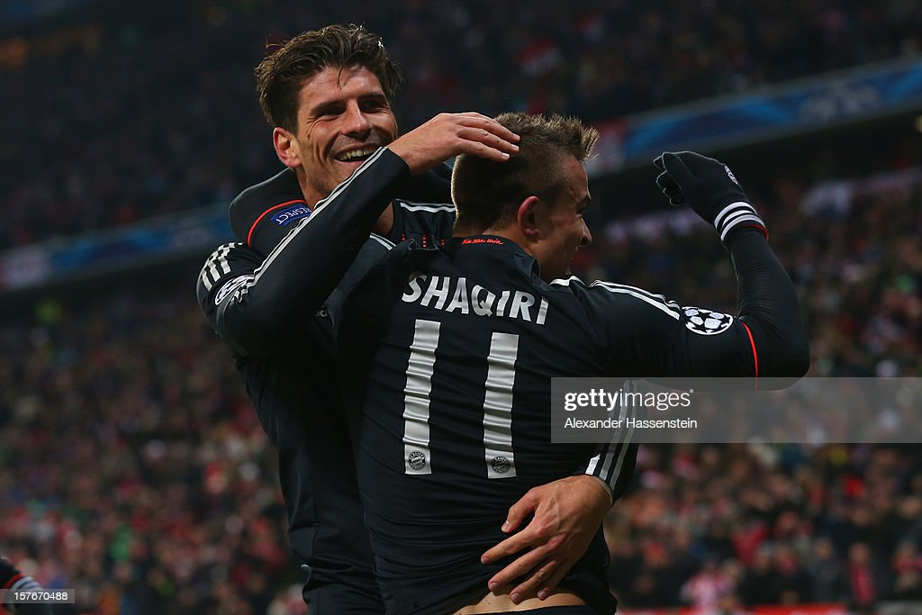 <a gi-track='captionPersonalityLinkClicked' href=/galleries/search?phrase=Xherdan+Shaqiri&family=editorial&specificpeople=6923918 ng-click='$event.stopPropagation()'>Xherdan Shaqiri</a> of Muenchen celebrates scoring the 3rd team goal with his team mate <a gi-track='captionPersonalityLinkClicked' href=/galleries/search?phrase=Mario+Gomez+-+Soccer+Player&family=editorial&specificpeople=635161 ng-click='$event.stopPropagation()'>Mario Gomez</a> during the UEFA Champions League Group F match between FC Bayern Muenchen and FC BATE Borisov at Allianz Arena on December 5, 2012 in Munich, Germany.
