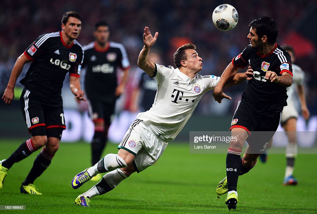 <a gi-track='captionPersonalityLinkClicked' href=/galleries/search?phrase=Xherdan+Shaqiri&family=editorial&specificpeople=6923918 ng-click='$event.stopPropagation()'>Xherdan Shaqiri</a> of Muenchen is challenged by Emir Spahic of Leverkusen during the Bundesliga match between Bayer Leverkusen and FC Bayern Muenchen at BayArena on October 5, 2013 in Leverkusen, Germany.