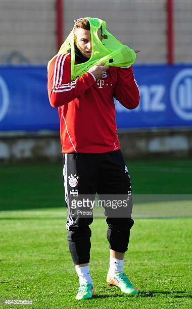 Xherdan Shaqiri of Muenchen puts on a jersey during a training session of FC Bayern Muenchen on January 22 2014 in Munich Germany