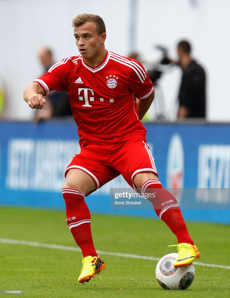 <a gi-track='captionPersonalityLinkClicked' href=/galleries/search?phrase=Xherdan+Shaqiri&family=editorial&specificpeople=6923918 ng-click='$event.stopPropagation()'>Xherdan Shaqiri</a> of Muenchen runs with the ball during the charity match between Hansa Rostock and FC Bayern Muenchen at DKB-Arena on July 14, 2013 in Rostock, Germany.