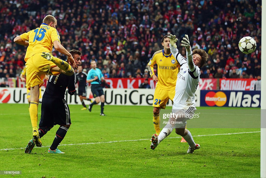<a gi-track='captionPersonalityLinkClicked' href=/galleries/search?phrase=Xherdan+Shaqiri&family=editorial&specificpeople=6923918 ng-click='$event.stopPropagation()'>Xherdan Shaqiri</a> of Muenchen scores his team's third goal against Maksim Bordachev and goalkeeper Andrey Gorbunov of Borisov during the UEFA Champions League Group F match between FC Bayern Muenchen and FC BATE Borisov at Allianz Arena on December 5, 2012 in Munich, Germany.