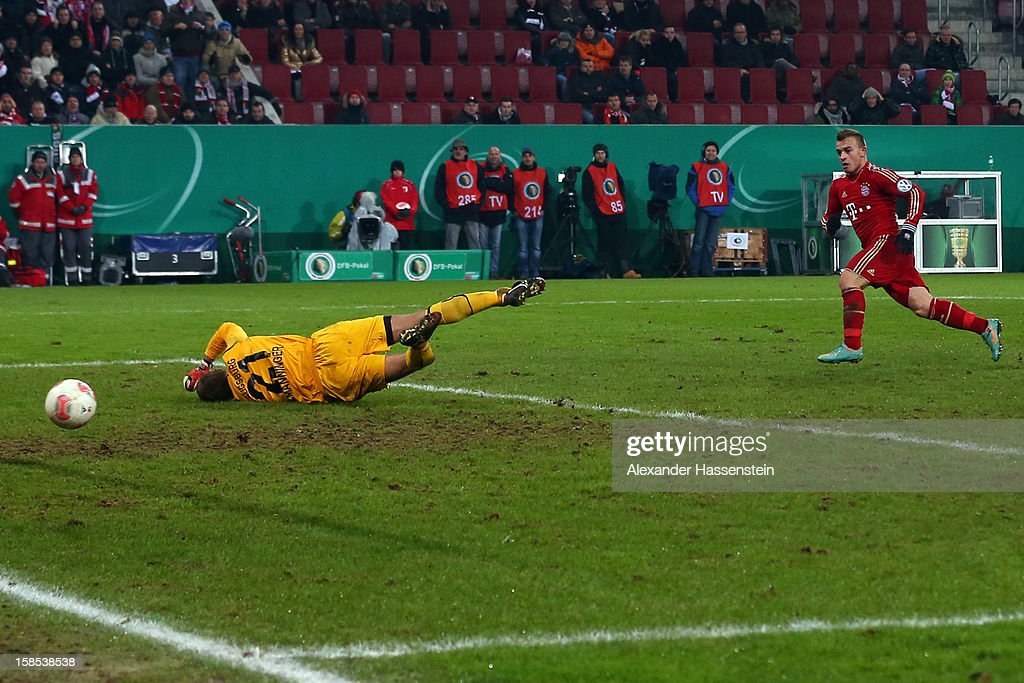 <a gi-track='captionPersonalityLinkClicked' href=/galleries/search?phrase=Xherdan+Shaqiri&family=editorial&specificpeople=6923918 ng-click='$event.stopPropagation()'>Xherdan Shaqiri</a> (R) of Muenchen scores the 2nd team goal against <a gi-track='captionPersonalityLinkClicked' href=/galleries/search?phrase=Alexander+Manninger&family=editorial&specificpeople=167082 ng-click='$event.stopPropagation()'>Alexander Manninger</a>, keeper of Augsburg during the DFB cup round of sixteen match between FC Augsburg and FC Bayern Muenchen at SGL Arena on December 18, 2012 in Augsburg, Germany.