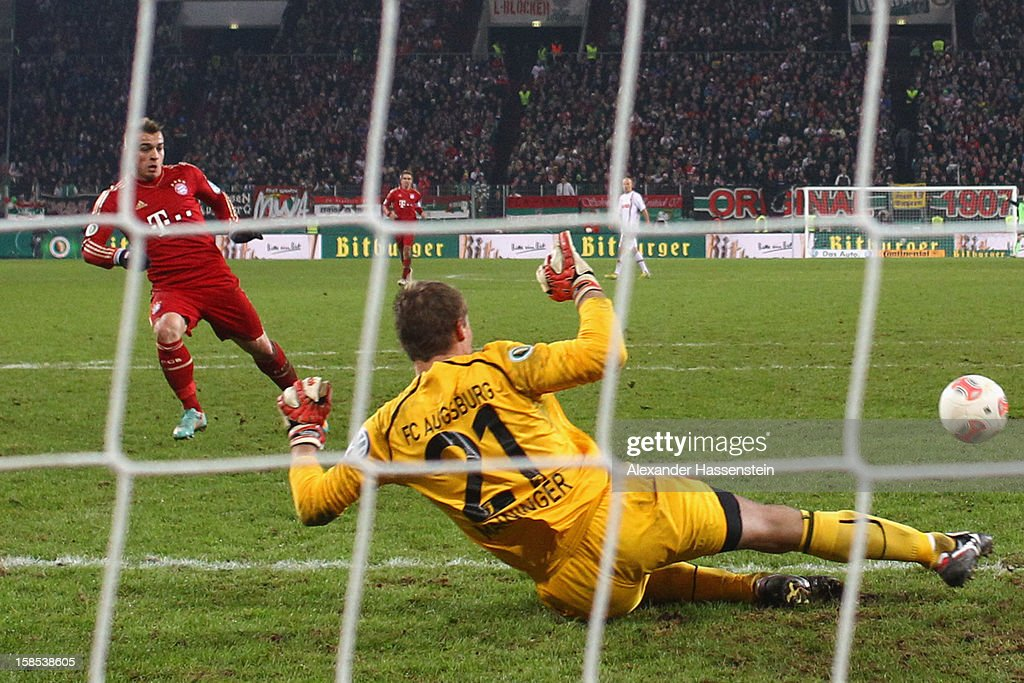 <a gi-track='captionPersonalityLinkClicked' href=/galleries/search?phrase=Xherdan+Shaqiri&family=editorial&specificpeople=6923918 ng-click='$event.stopPropagation()'>Xherdan Shaqiri</a> (L) of Muenchen scores the 2nd team goal against <a gi-track='captionPersonalityLinkClicked' href=/galleries/search?phrase=Alexander+Manninger&family=editorial&specificpeople=167082 ng-click='$event.stopPropagation()'>Alexander Manninger</a>, keeper of Augsburg during the DFB cup round of sixteen match between FC Augsburg and FC Bayern Muenchen at SGL Arena on December 18, 2012 in Augsburg, Germany.