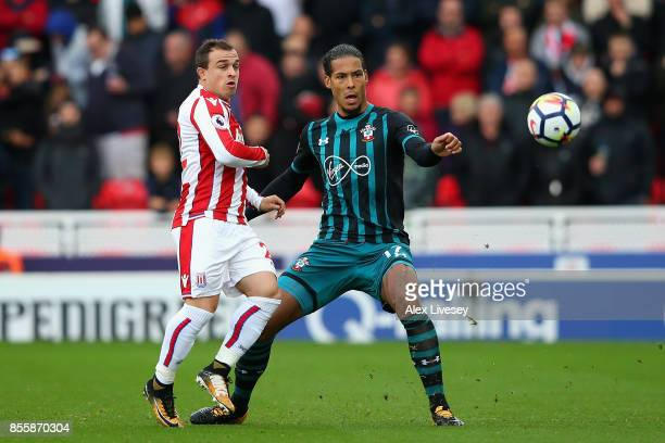 Xherdan Shaqiri of Stok City and Virgil van Dijk of Southampton battle for possession during the Premier League match between Stoke City and...