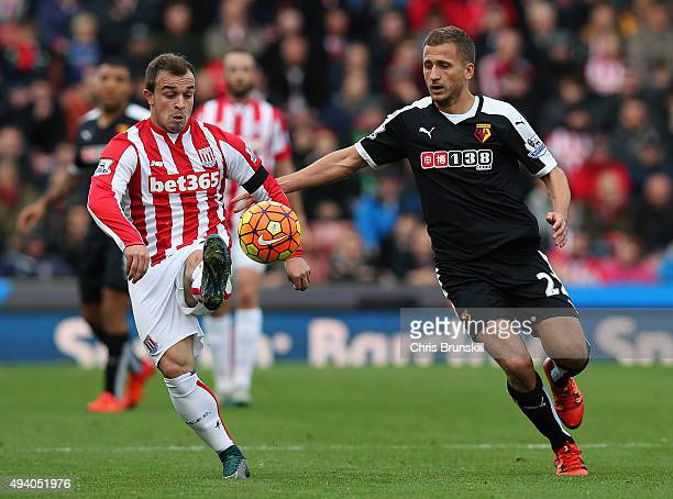 Xherdan Shaqiri of Stoke City and Almen Abdi of Watford compete for the ball during the Barclays Premier League match between Stoke City and Watford...