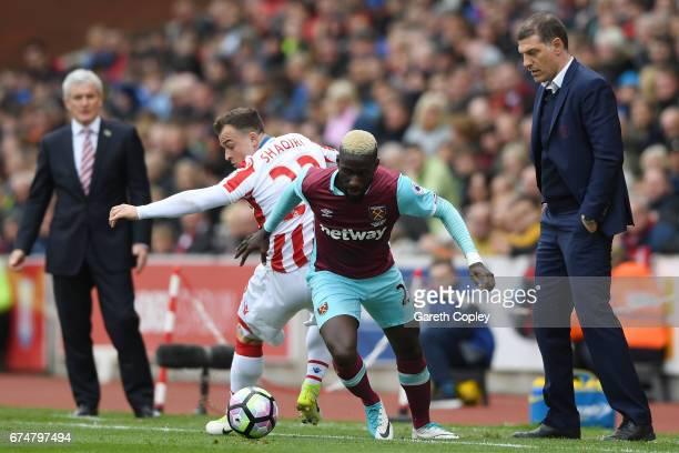 Xherdan Shaqiri of Stoke City and Arthur Masuaku of West Ham United clash during the Premier League match between Stoke City and West Ham United at...
