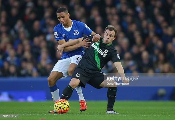 Xherdan Shaqiri of Stoke City and Brendan Galloway of Everton compete for the ball during the Barclays Premier League match between Everton and Stoke...