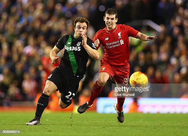 Xherdan Shaqiri of Stoke City and Jon Flanagan of Liverpool chase the ball during the Capital One Cup semi final second leg match between Liverpool...