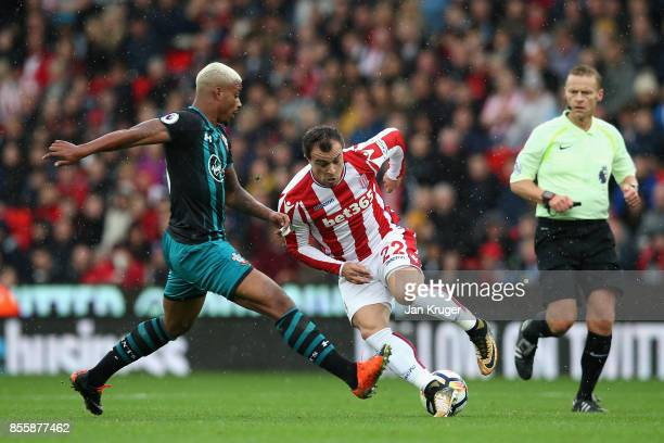 Xherdan Shaqiri of Stoke City and Mario Lemina of Southampton battle for possession during the Premier League match between Stoke City and...